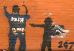 This graffiti appeared on the wall of a youth center.